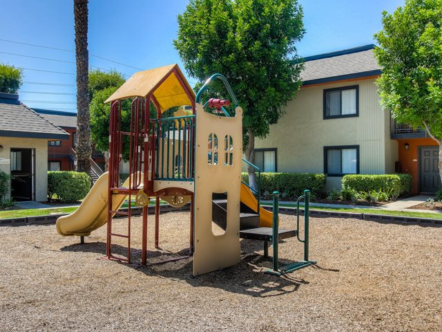Community Playground With Tot lot at Riverwalk Landing Apartment Homes, California, 92505
