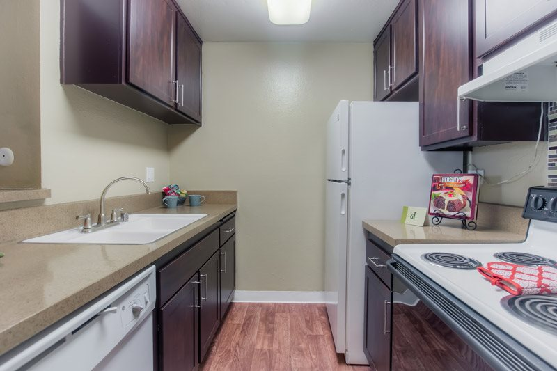 Spacious Kitchen with Pantry Cabinet at Chatsworth Pointe Apartments, Canoga Park, CA