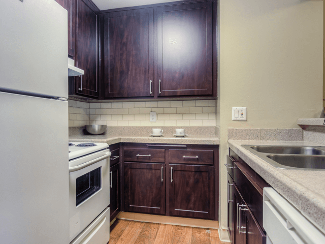 Spacious Kitchen with Pantry Cabinet at Nortview-Southview Apartment Homes, Reseda, CA