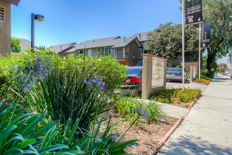 Lush landscaping at Independence Plaza Apartments, 8735 Independence Avenue, CA