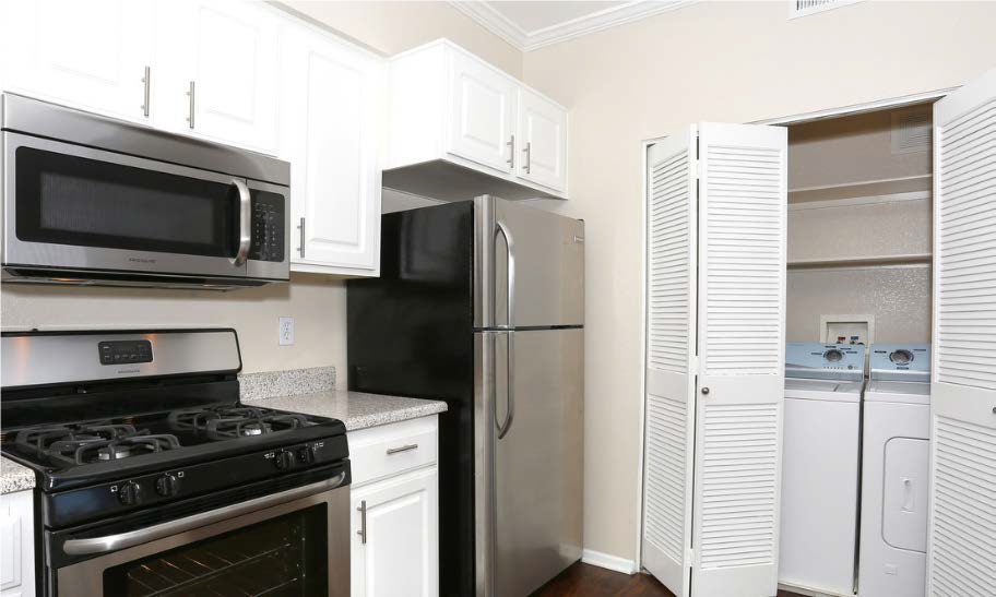 Spacious Kitchen with Pantry Cabinet at Estancia Apartment Homes