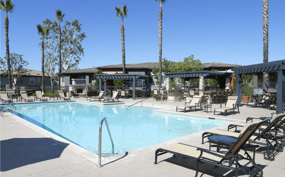 Lounging By The Pool at Estancia Apartment Homes, California, 92508