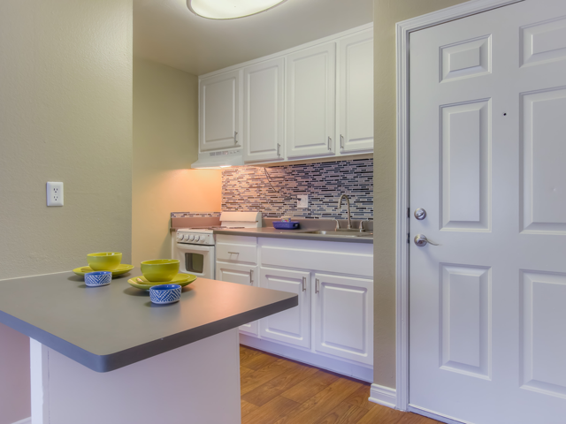 Gourmet Kitchen with Breakfast Bar and Pantry at Twenty 2 Eleven Apartments, Canoga Park, 91306