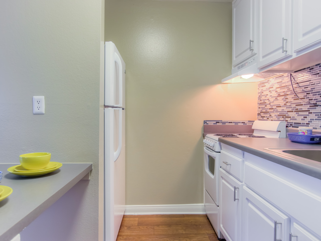 Fully equipped kitchen at Twenty 2 Eleven Apartments, Canoga Park, CA