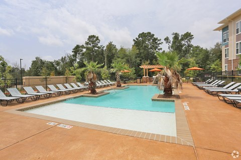 Pool with Tanning Shelf Apartments located in Conroe