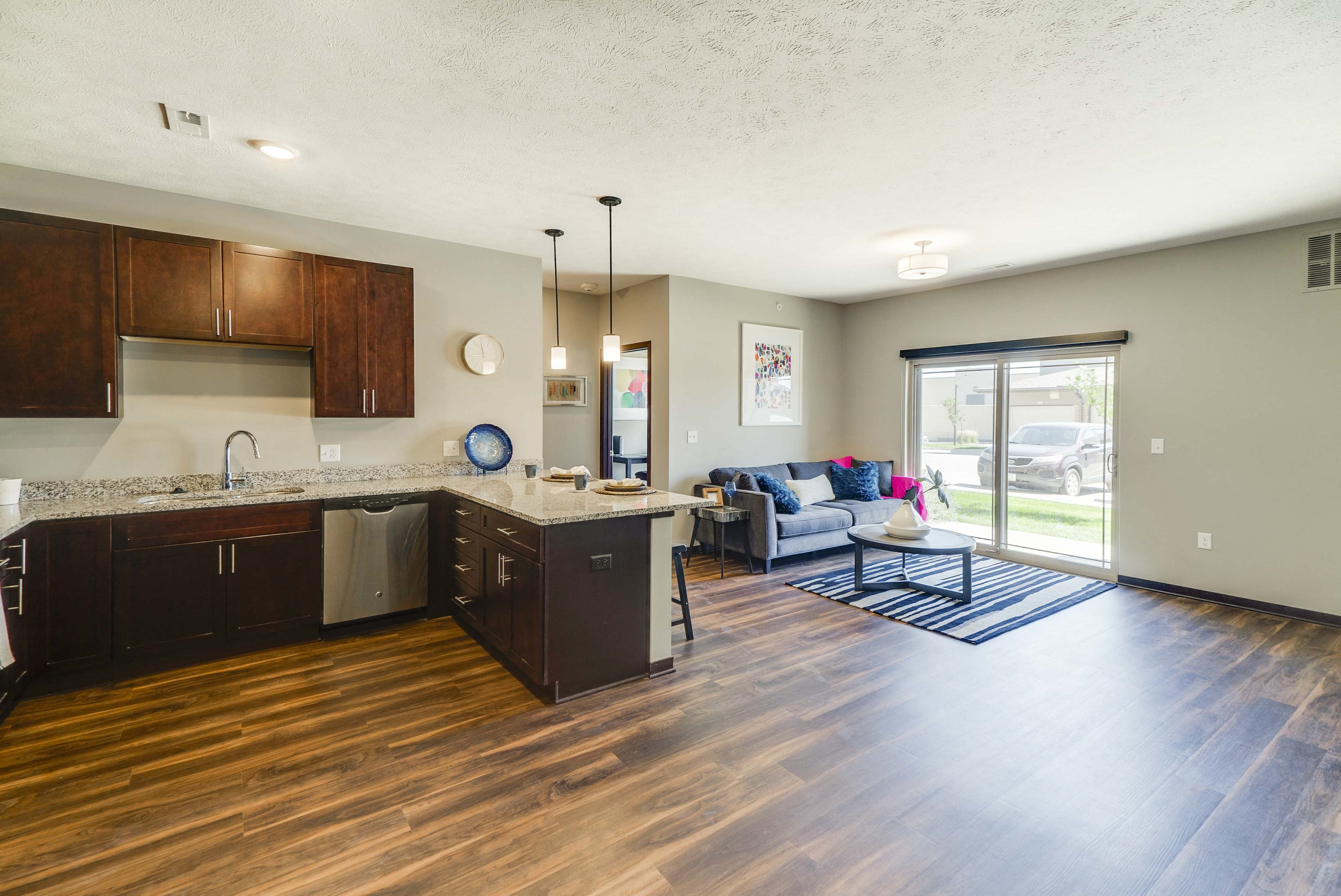 Spacious living room and kitchen of 2 bedroom apartment for rent at 360 at Jordan West best new apartments West Des Moines IA 50266