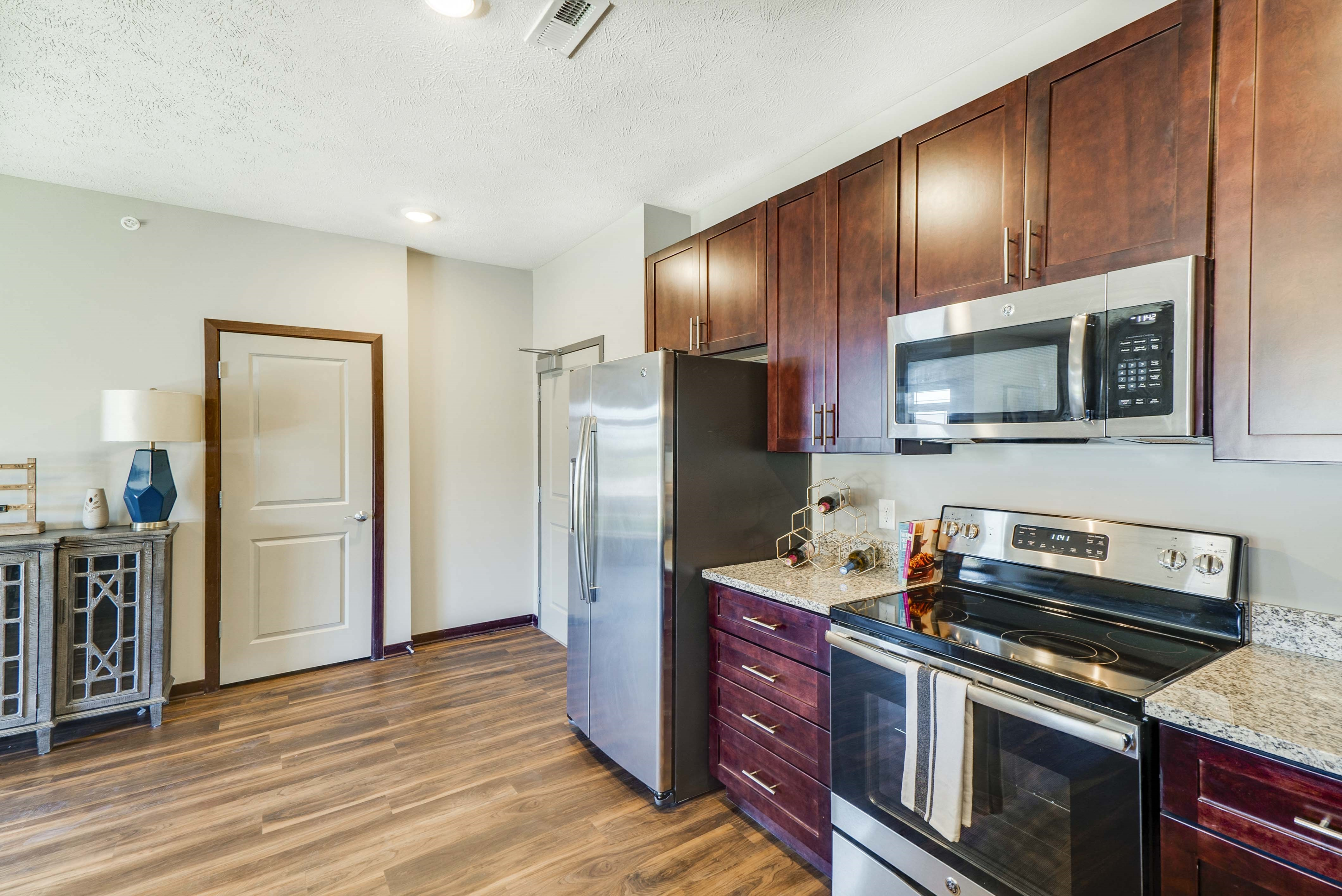 Spacious kitchen with granite countertops of 2 bedroom apartment for rent at 360 at Jordan West best new apartments West Des Moines IA 50266