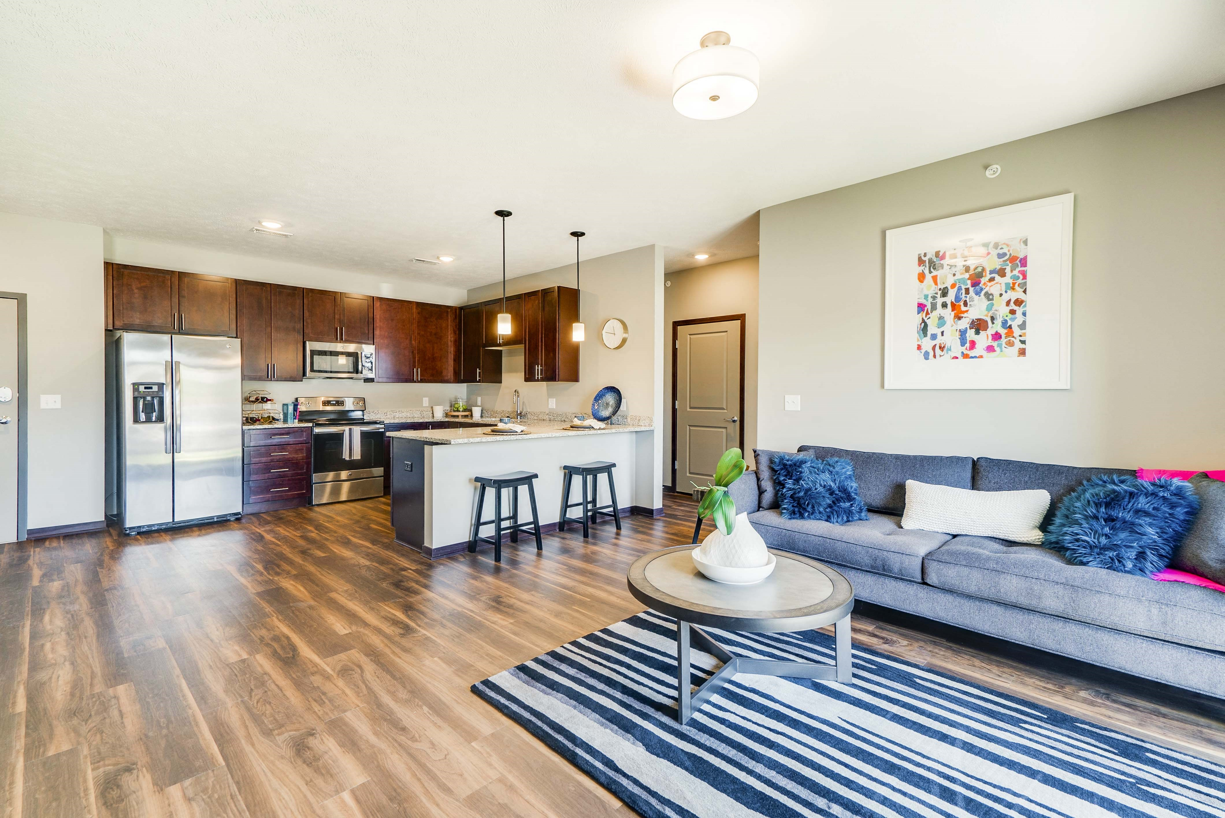 Spacious kitchen and living space in a 2 bedroom apartment for rent at 360 at Jordan West best new apartments West Des Moines IA 50266