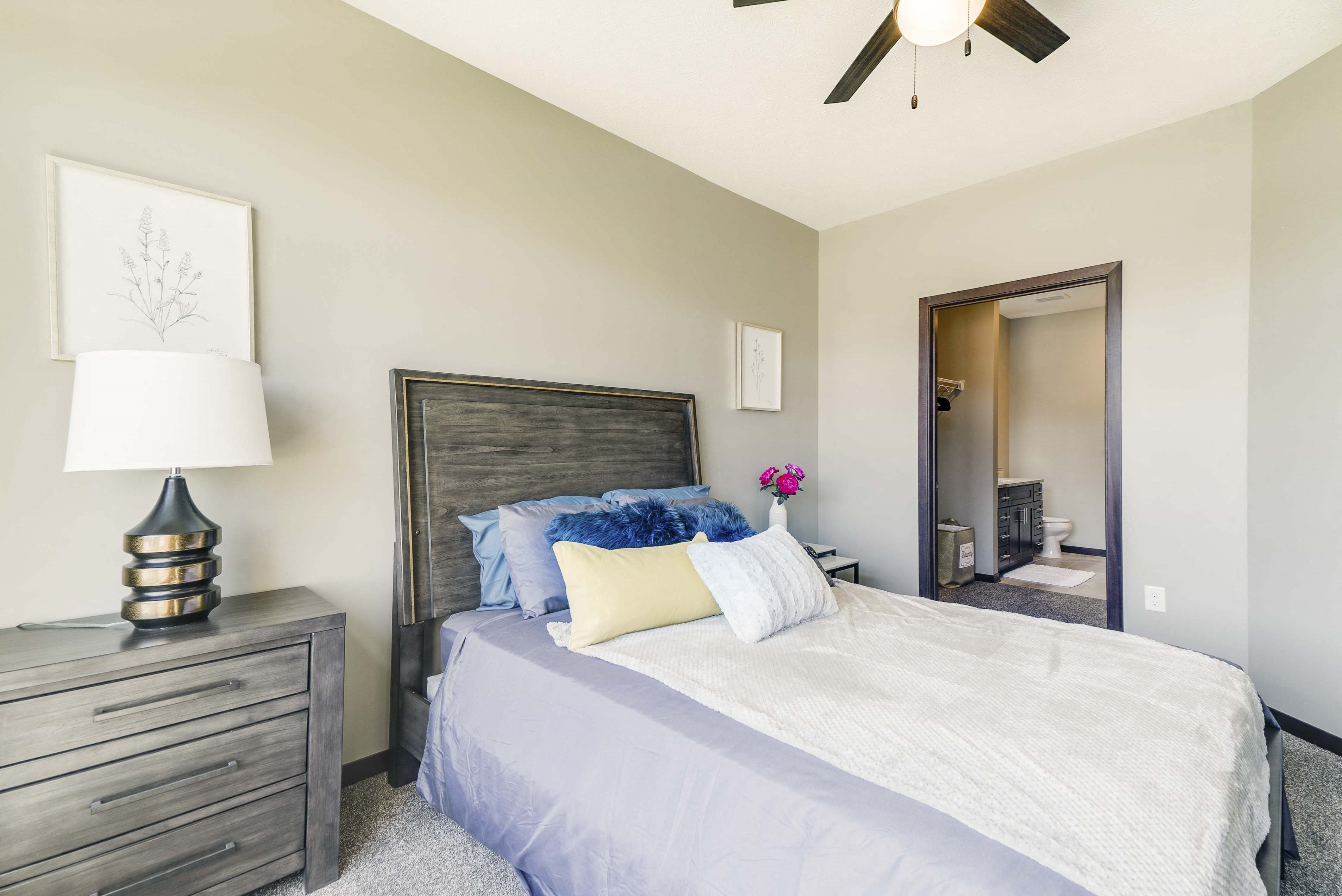 Large bedroom with attached bathroom with shower and granite countertops in 2 bedroom apartment for rent at 360 at Jordan West best new apartments West Des Moines IA 50266