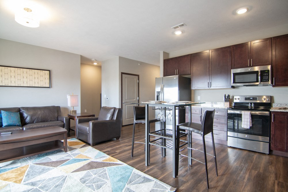 Open layout with dining and living room in a one bedroom with denat 360 at Jordan West best new apartments West Des Moines IA 50266
