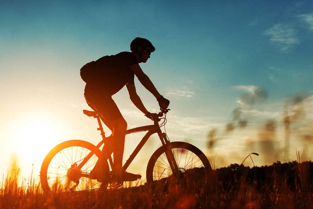 Resident biking on trail near 360 at Jordan West best new apartments West Des Moines IA 50266