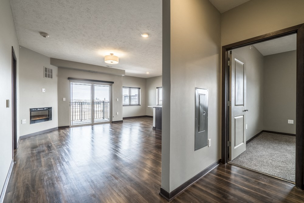 View of living room in two bedroom apartment with hardwood-style floors at 360 at Jordan West best new apartments West Des Moines IA 50266