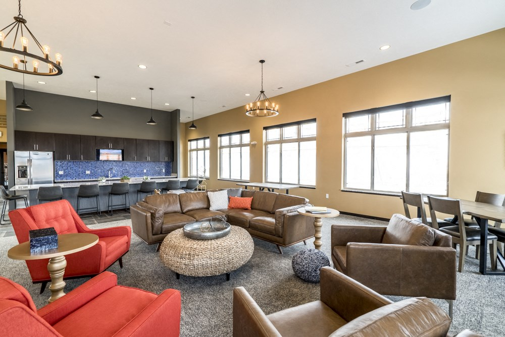 Clubhouse with seating and deluxe kitchen for entertaining at 360 at Jordan West best new apartments West Des Moines IA 50266