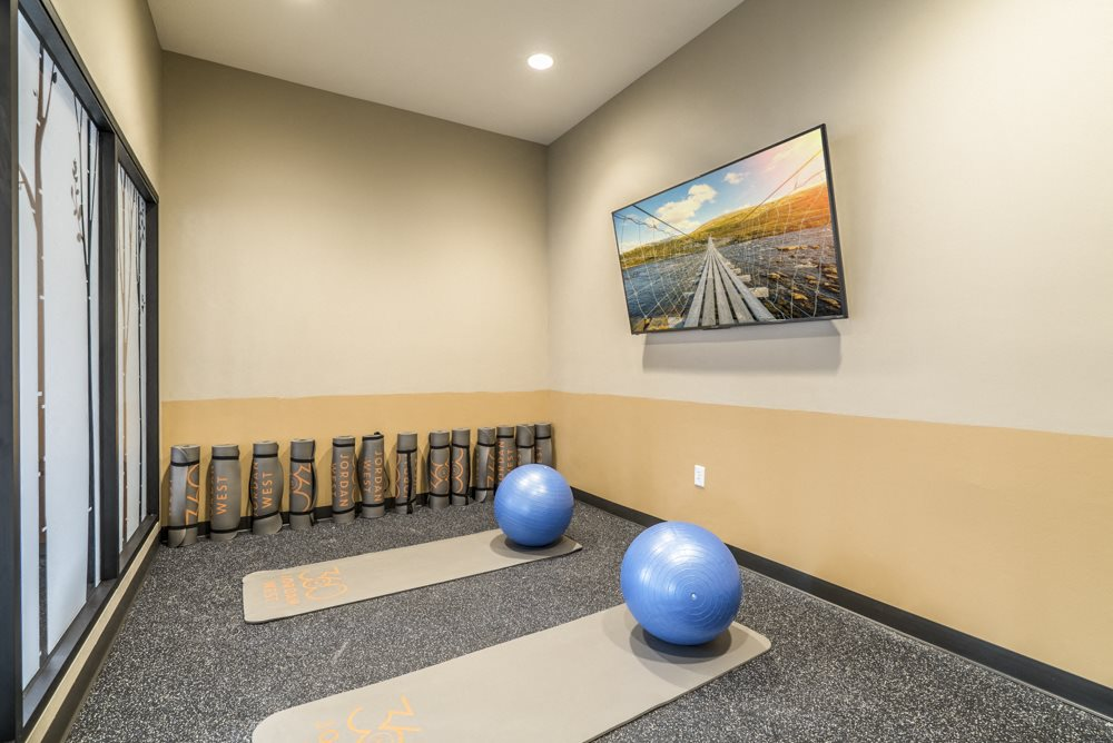 Yoga room with on-demand classes at 360 at Jordan West best new apartments West Des Moines IA 50266