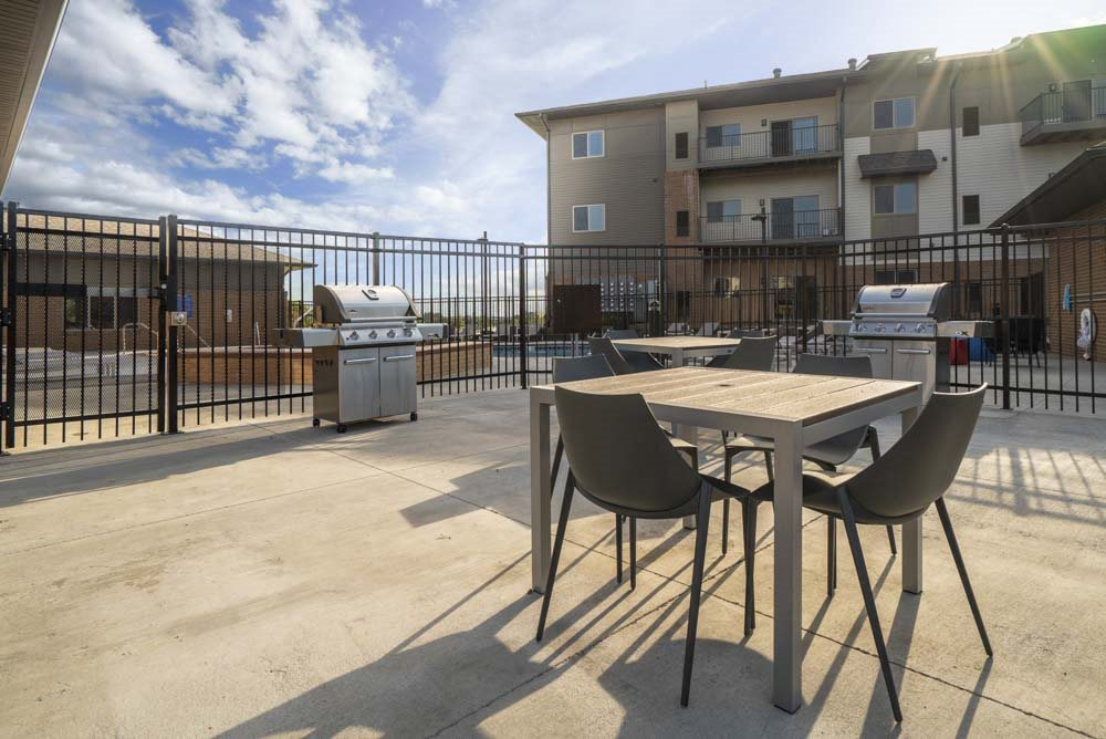 Outdoor seating and grill at 360 at Jordan West best new apartments West Des Moines IA 50266