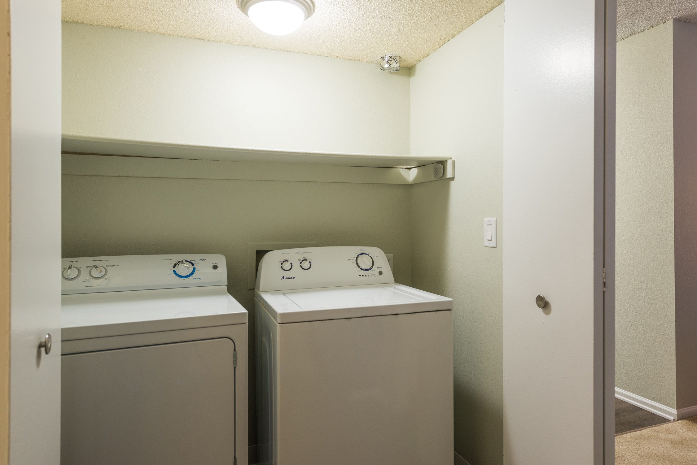 Laundry Room at Conifer Creek Apartments in Aurora, IL