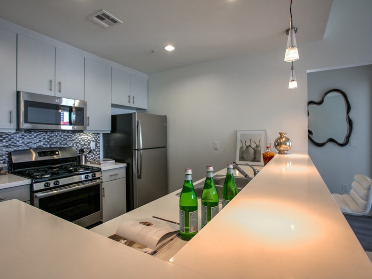 Modern, Stainless Steel Appliances and Gas Range, at Legendary Glendale Apartments, 300 N Central Ave, CA