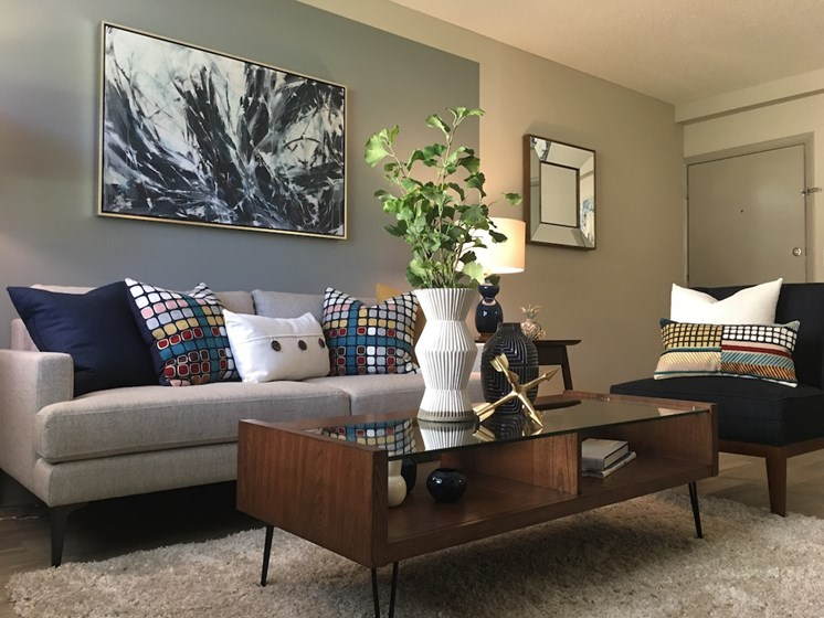 The Mark at SoDo South Downtown Orlando, FL 32806 Living room with designer paint colors and hardwood-inspired flooring