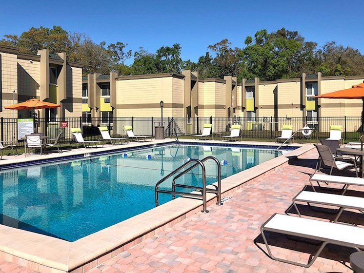 renovated Resort Style Pool with pool furniture at The Mark at SoDo, Orlando, FL