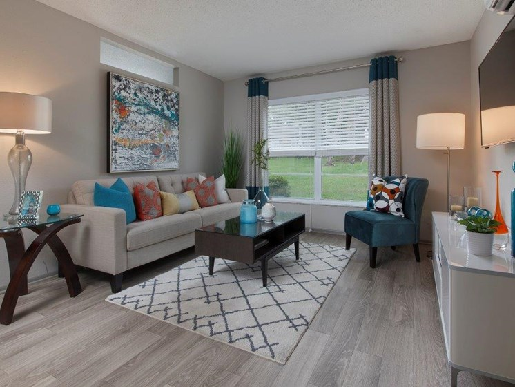 The Mark at SoDo South Downtown Orlando, FL 32806 Living Room with natural light and hardwood style flooring