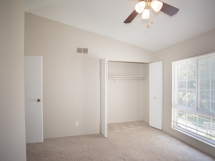 Large bedroom with closet and overhead lighting at Forest Park Apartments in North Kansas City, MO