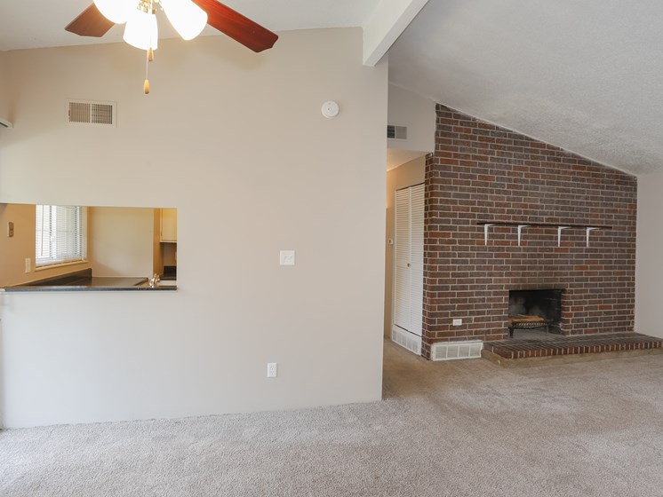 brick fireplaces in living room at forest park apartments in North Kansas City, MO