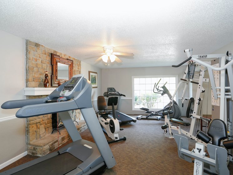 Community Fitness Center with machines at Forest Park Apartments in North Kansas City, MO