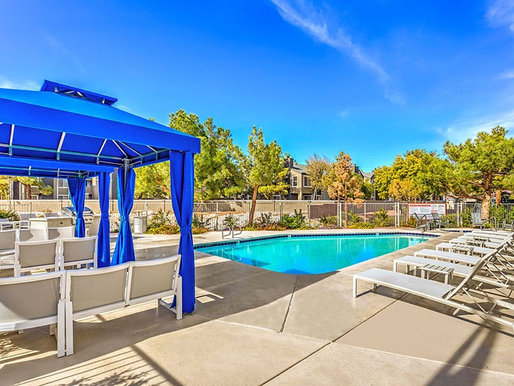 Newly Renovated Apartments in Las Vegas Nevada - The Edmond at Hacienda Swimming Pool With Poolside Seating and Cabanas