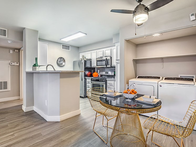 Las Vegas Apartments - The Edmond at Hacienda Kitchen, Dining Area and Adjust Laundry Area With Stainless Steel Appliances and Modern Fixtures