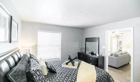 Spacious Bedroom with Natural Light and Hardwood Style Flooring