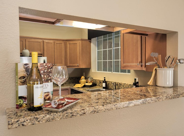 Gourmet Kitchen with Breakfast Bar and Pantry at Larkspur Woods Apartment Homes, 2900 Weald Way