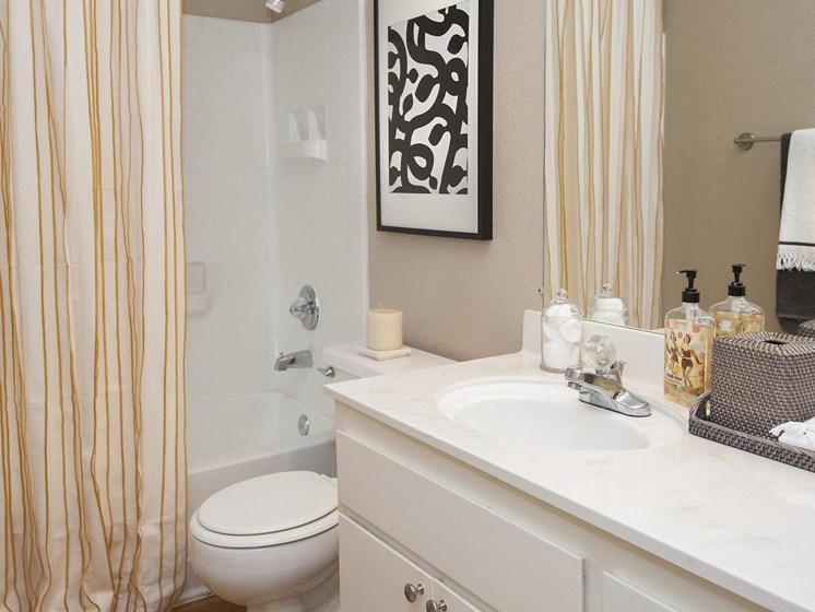 Large Soaking Tub In Master Bathroom with A Tile Surround at Larkspur Woods Apartment Homes, Sacramento, California
