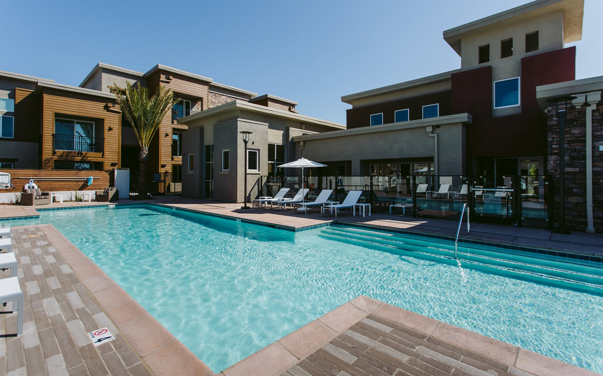 Pool and Lounge Chairs  l Garnet Creek Apartments in Rocklin, Ca with pool