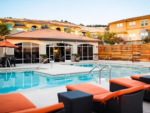 Apartments in El Dorado Hills, CA l Lesarra Apartments l Pool and lounge chairs