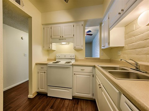 Spacious Kitchen with Pantry Cabinet at Fountain Plaza Apartments, Tucson, AZ
