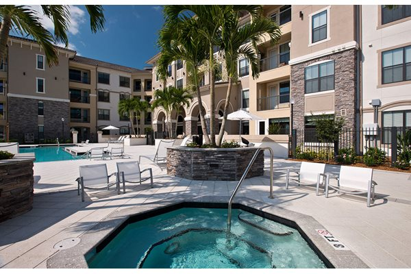 Relax and unwind in the hot tub at Anson on Palmer Ranch in Florida.