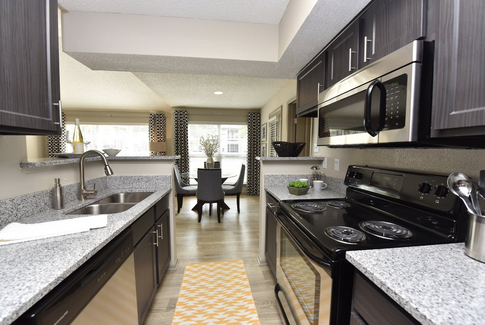 The Metropolitan Apartments in Augusta, GA 30909 Kitchen view into dining  area