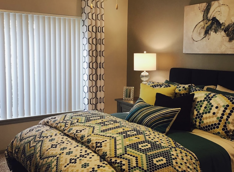 Terraces at Summerville Apartments in Augusta, GA 30904 spacious bedroom with plush carpeting and ceiling fan