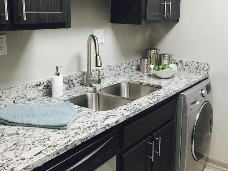 Terraces at Summerville Apartments in Augusta, GA 30904 granite countertops with undermount sink and spray faucet
