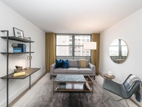 Upscale Open Concept Living Room at Wave, Chicago, 60657