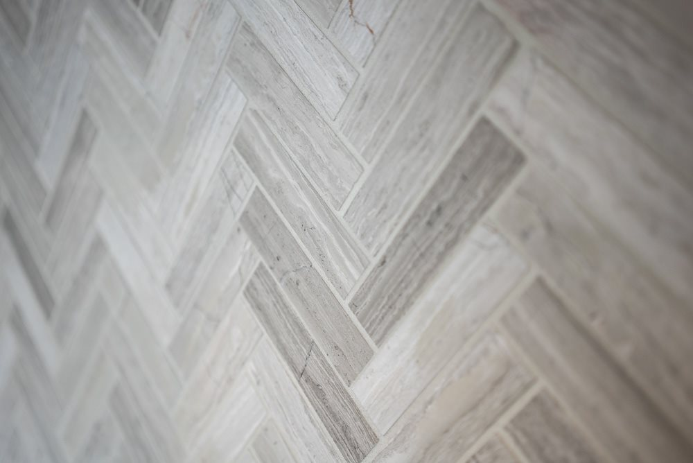 Custom-designed tile back splash in premium unit at Ascend at Woodbury new luxury apartments in Woodbury MN 55129