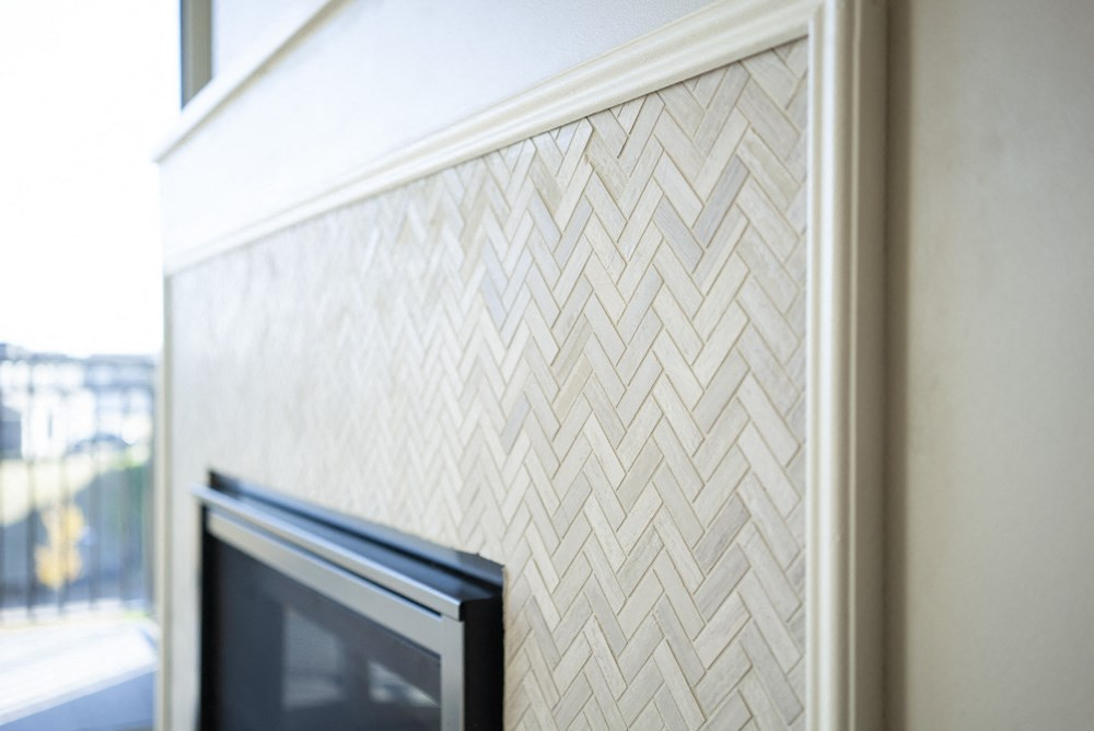 Custom designed tile surround fireplace in at Ascend at Woodbury new luxury apartments in Woodbury MN 55129
