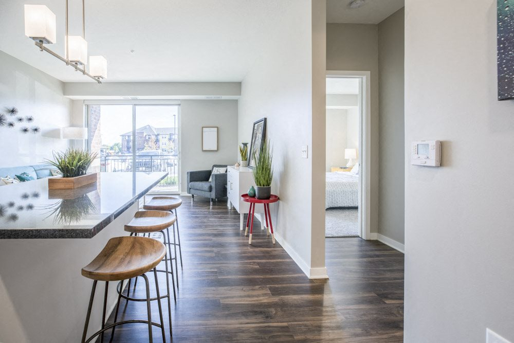 Open layout with view of living room from kitchen at Ascend at Woodbury new luxury apartments in Woodbury MN 55129
