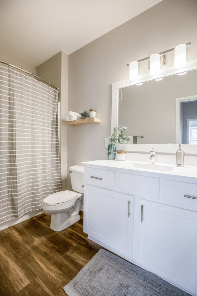 Bathroom with white cabinetry at Ascend at Woodbury new luxury apartments in Woodbury MN 55129