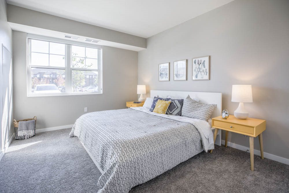 Bedroom with large windows at Ascend at Woodbury new luxury apartments in Woodbury MN 55129