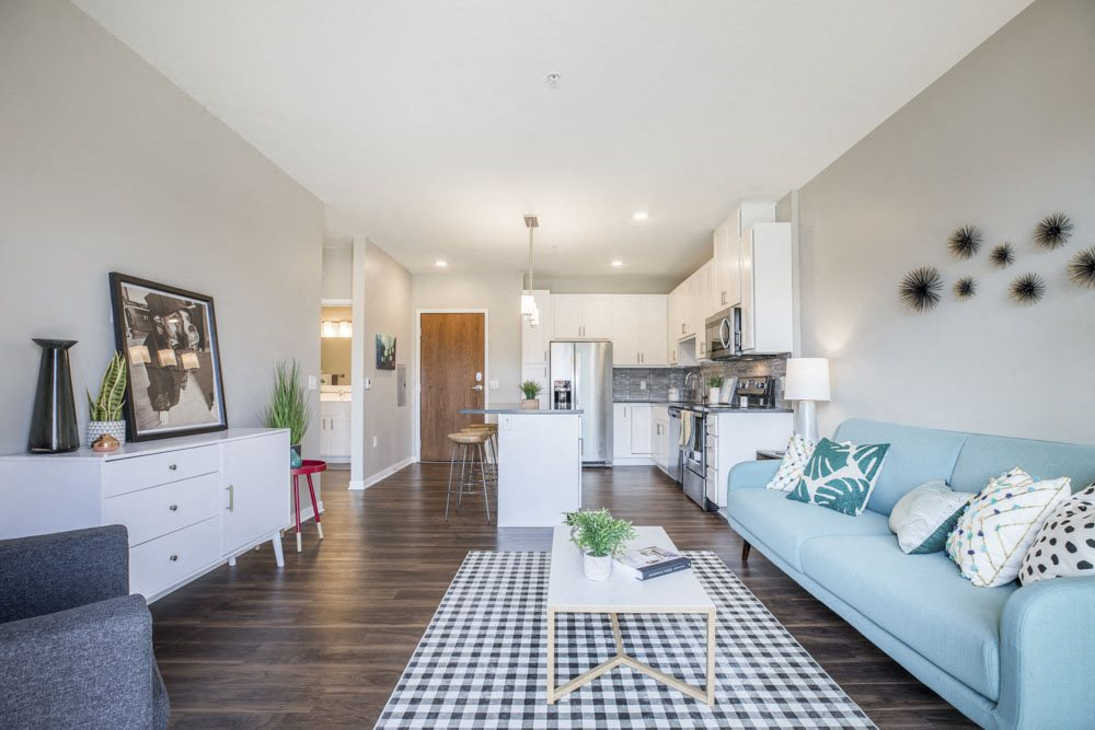 Open floor plan with hardwood floors and white cabinetry at Ascend at Woodbury MN 55129 new luxury apartments
