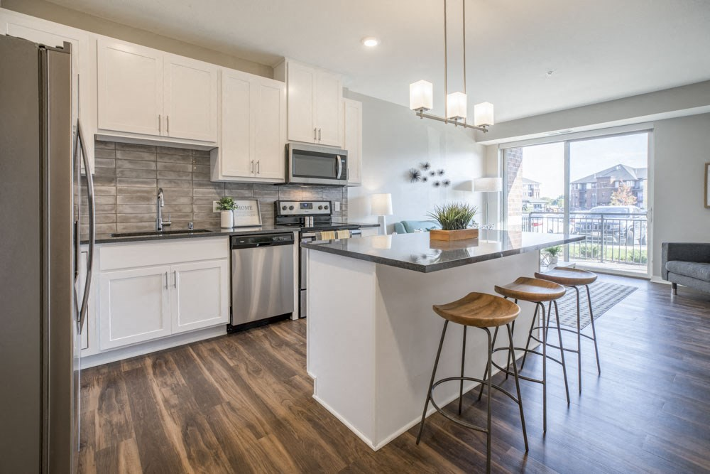 Kitchen with pendant lighting and island at Ascend at Woodbury new luxury apartments in Woodbury MN 55129