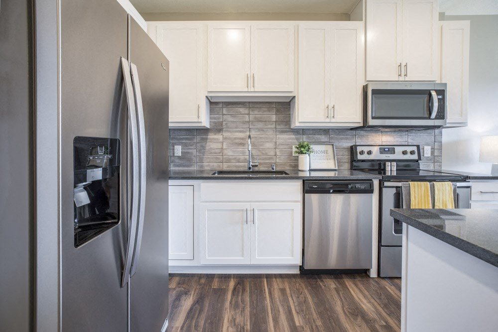 Stainless-steel appliances with side-by-side fridge at Ascend at Woodbury MN 55129 new luxury apartments