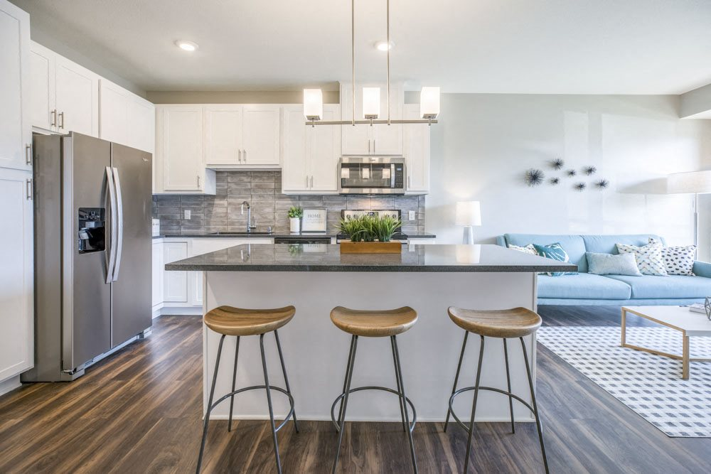 Alpine design scheme with kitchen island at Ascend at Woodbury MN 55129 new luxury apartments