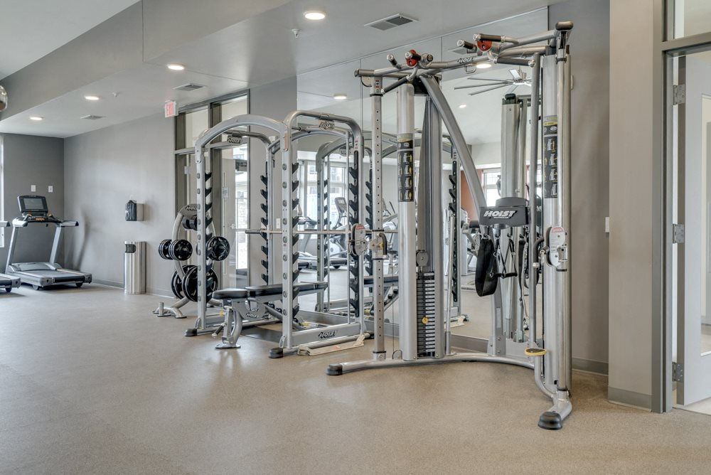 Large fitness center with free weights, weightlifting machines and cardio equipment at Ascend at Woodbury in MN